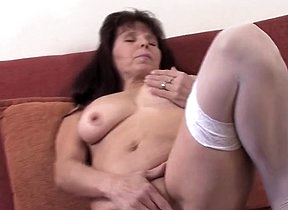 Aroused mature woman feels her pussy getting wet
