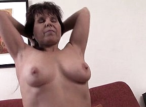 Aroused mature woman feels her pussy getting wet as fuck while deep fingering and moaning part of a openly solo appearance on chum around with annoy couch during a home cam play