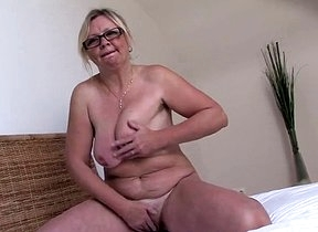 Home alone granny feels like posing nude for the