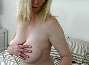 Naughty blonde mature lady playing with her