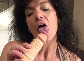 Blistering housewife getting ready with her dildo