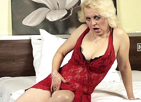 Blonde mature floosie going at it on her bed
