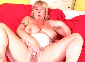 Horny chubby housewife playing with a dildo