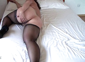 Naughty mature slut getting wet on her bed