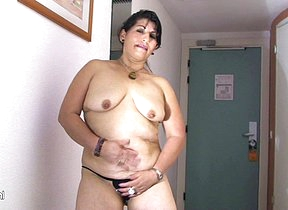 Hot mama playing hither a big toy