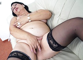 This horny mama loves to get wet overhead her couch