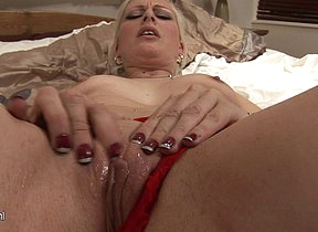 Horny blonde slut playing with her wet pussy