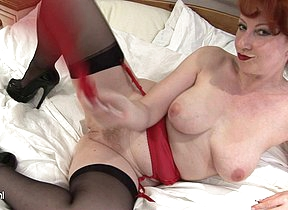Horny red MILF getting herself off